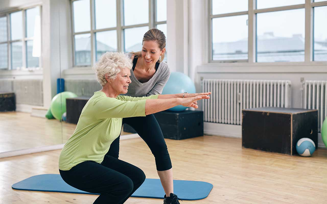 personal-trainer-with-elderly-woman